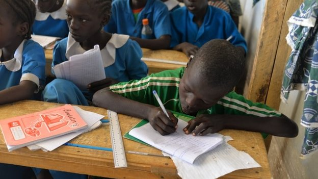 Children attend classes on 13 November 2014 in a UNHCR camp for Nigerian refugees in Minawao, in the extreme north-west of Cameroon