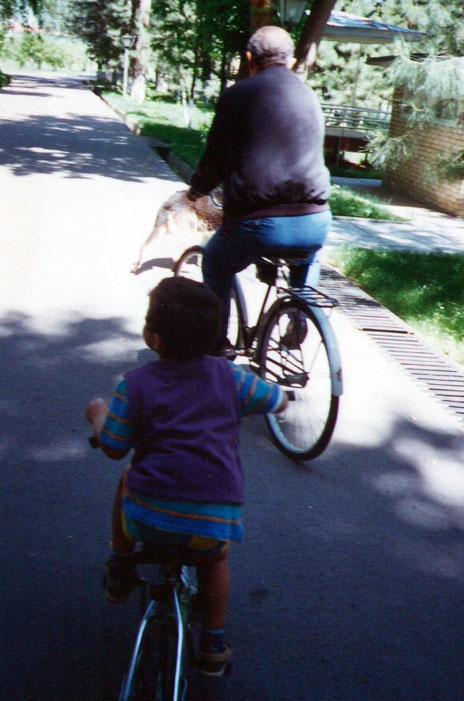 Islam Karimov Jr and Islam Karimov Sr on their bicycles