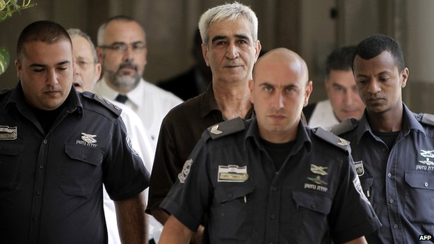 Ahmed Saadat (C) is escorted by Israeli police as he arrives to attend a hearing in his trial at a court in Jerusalem in September 2012
