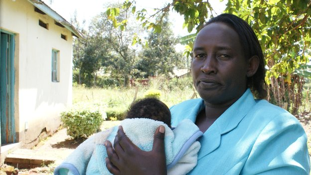 Child welfare worker with rescued baby