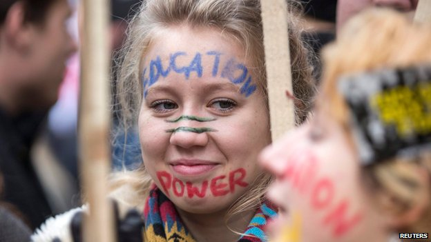 Demonstrators participate in a protest against student loans and in favour of free education, in central London November 19, 2014