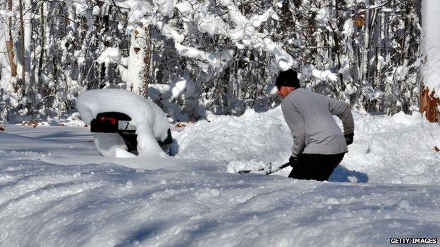A man ploughs snow in Buffalo, New York, on 19 November 2014