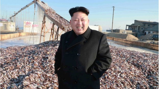 An undated picture made available by the North Korean Central News Agency (KCNA) on 20 November 2014 shows North Korean leader Kim Jong-un touring a military fisheries processing factory at an unknown location in North Korea.