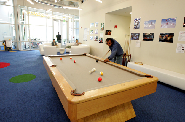 Man plays pool at Google offices