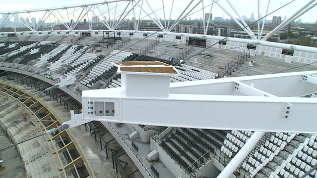 Up above the stadium's new roof structure