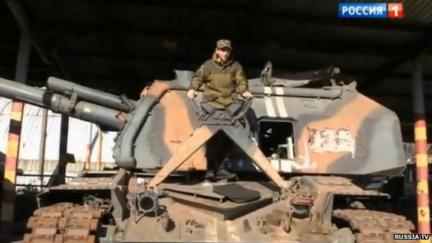 Young man on top of a tank