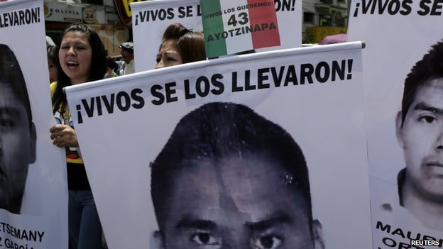 Bolivian students hold banners, with photographs of missing Mexican students, during a rally in support their support in La Paz, on 20 November 2014.