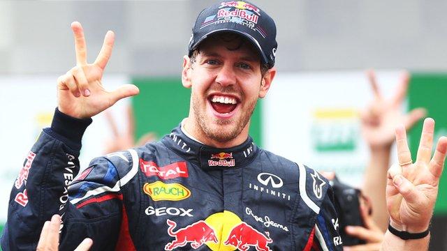 Sebastian Vettel celebrates after winning his third world title
