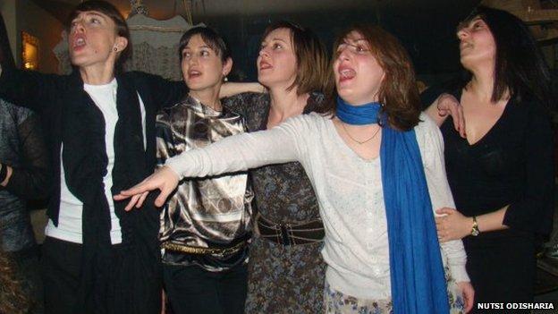 Women singing in karaoke club in Georgia