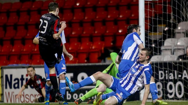 Gavin Whyte scores the first goal for Crusaders against Coleraine