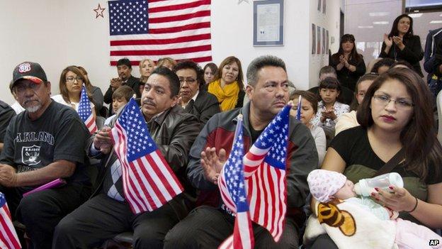Oscar Cortez, Enrique Bravo, Leonel Flores and Cristina Gutierrez listen to speakers at Nevada Headquarters of Mi Familia Vota before heading to Las Vegas, 21 Nov