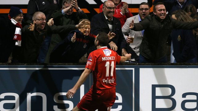 Tim Mouncey celebrates his late winner with Portadown fans