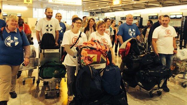 The group of NHS volunteers preparing to check in