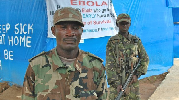 Lt Martin Tejan (left) at an Ebola checkpoint in Sierra Leone, 21 November 2014