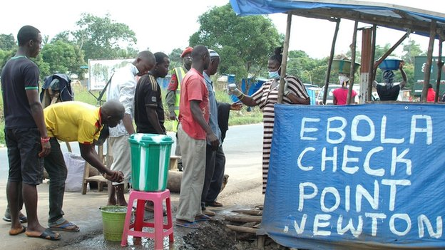 People at an Ebola checkpoint in Sierra Leone, 21 November 2014