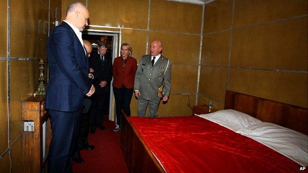Albanian Prime Minister Edi Rama, left, looks at the bedroom of late communist dictator Enver Hoxha at a bunker built in Tirana - 22 November 2014