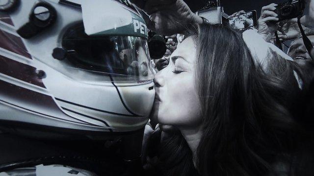 Lewis Hamilton kisses Nicole Scherzinger