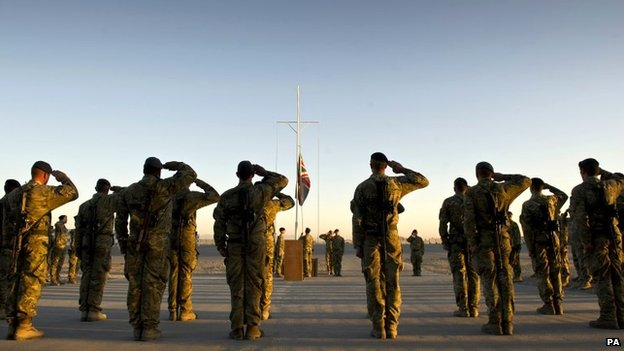 Garrison Sergeant Major (GSM) WO Andrew Stephens (RAF) lowering the Union flag for the last time at Kandahar Air base, Afghanistan