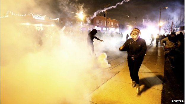 Protesters and tear gas in Ferguson, 24 November 2014