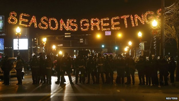 Police form a line in the street under a holiday sign after a grand jury returned no indictment in the shooting of Michael Brown in Ferguson, Missouri November 24, 2014.
