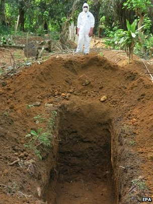 Burial worker at Kenema