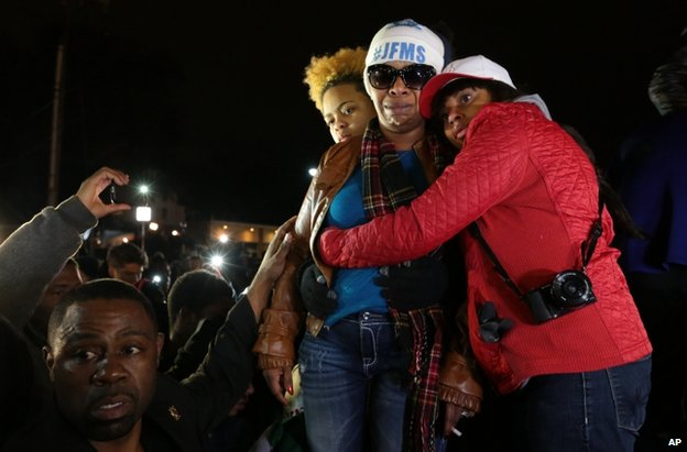 Mr Brown's mother, Lesley McSpadden, is comforted by supporters in Ferguson, 24 November