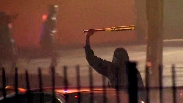 Protestor holds bat