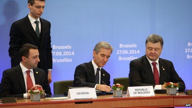 Georgian Prime Minister Irakli Garibashvili (left), Moldovan Prime Minister Iurie Leanca (second right) and Ukrainian President Petro Poroshenko (right) attend the second day of the EU summit on 27 June 2014 in Brussels.
