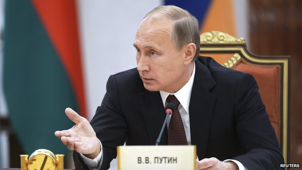 Russian President Vladimir Putin speaking at a summit of Commonwealth of Independent States leaders in the Belarusian capital Minsk in October 2014