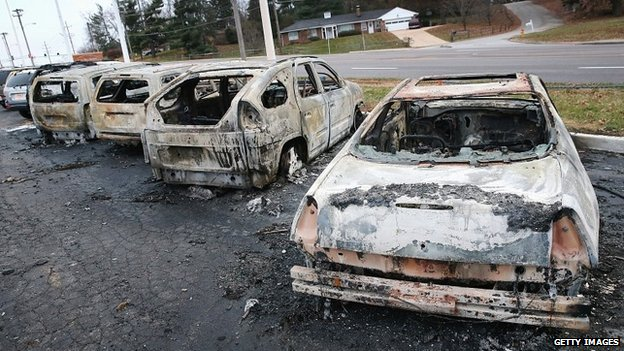The charred remains of cars that were set alight during riots in Dellword, Missouri - 25 November 2014