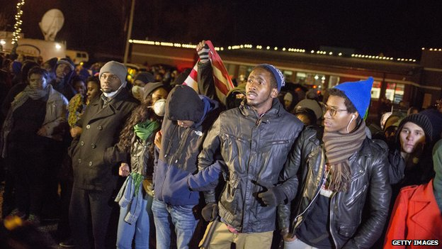 Protesters in Ferguson link arms