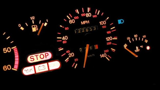 Car dashboard with warning lights