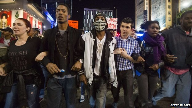 Demonstrators march on November 26, 2014 in Los Angeles during demonstrations against a decision by a Ferguson, Missouri grand jury to not indict a white police officer in the shooting of black teenager Michael Brown.