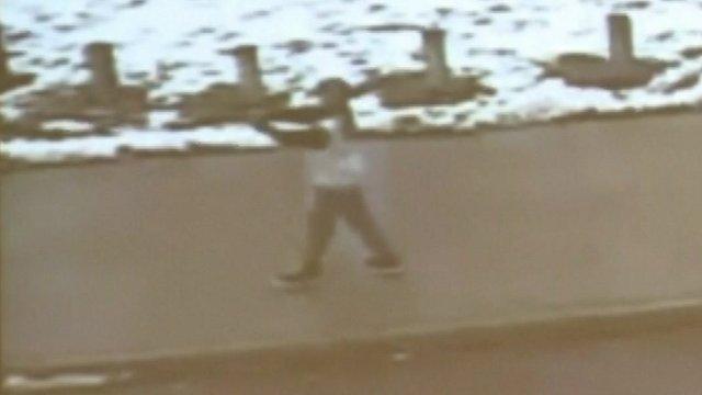 Boy pointing replica gun