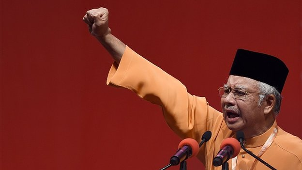 Malaysian Prime Minister Najib Razak addresses delegates during the annual congress of his ruling party, the United Malays National Organisation (UMNO) in Kuala Lumpur on November 27, 2014