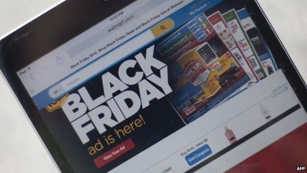 """""""Black Friday"""" advertisement for Walmart is seen on an iPad in Annapolis, Maryland November 16, 2014"""