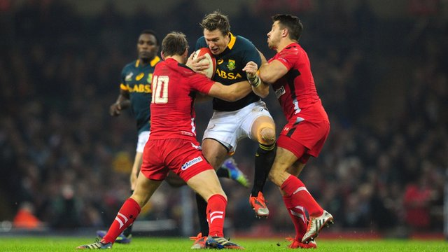 Wales players Dan Biggar and Rhys Webb tackle Jean de Villiers of South Africa during the Autumn international match between Wales and South Africa