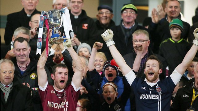 Slaughtneil captain Francis McEldowney lifts the Ulster club trophy