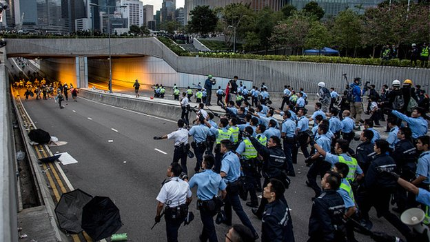 Police rush down Lung Wo road tunnel to clear pro-democracy protesters on December 1, 2014 in Hong Kong.