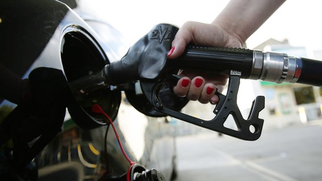Hand on petrol pump filling up car