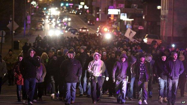 Bosnian protestors march through St Louis following the murder of Zemir Begic.