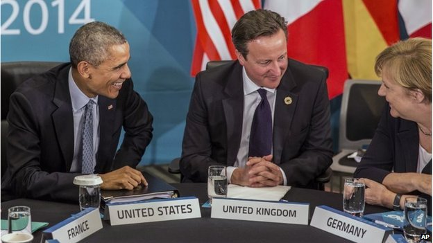 """U.S. President Barack Obama and Britain""""s Prime Minister David Cameron listen to Germany""""s Chancellor Angela Merkel as they attend the Transatlantic Trade and Investment Partnership (TTIP) meeting at the G20 the G-20 leaders summit in Brisbane, Australia, Sunday, Nov. 16, 2014."""
