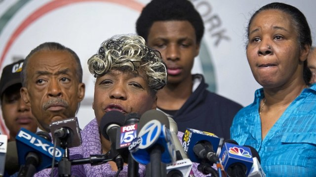 Eric Garner's mother Gwen Carr (centre front) and widow Esaw Garner (right)