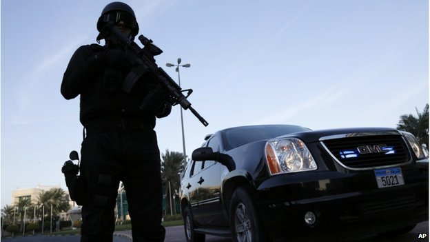 A police officer stands guard outside a security conference in Manama, Bahrain