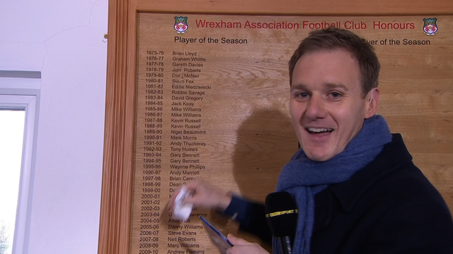 Presenter Dan Walker accidentally wipes a name off Wrexham's honours board during a live broadcast of Football Focus.