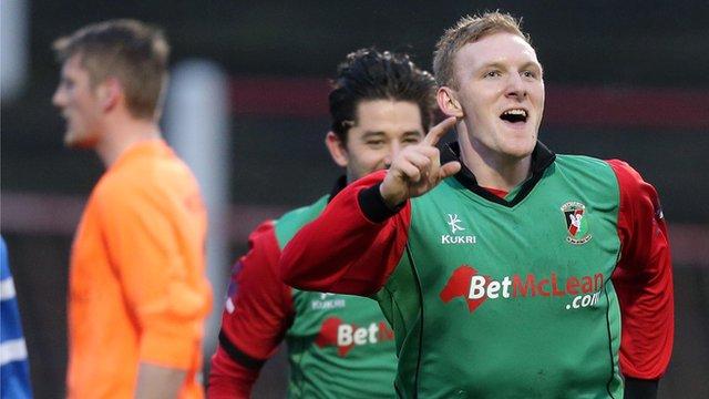 Glentoran's Steven Gordon celebrates scoring against Ballinamallard United at The Oval
