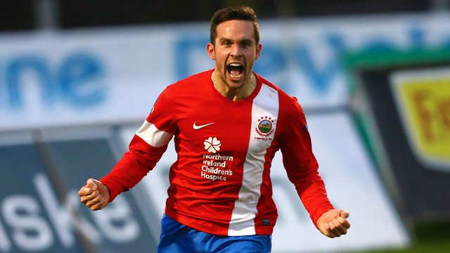 Linfield's Andrew Waterworth celebrates his goal against Ballymena United
