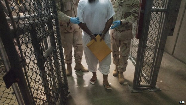 File photo shows US military guards move a detainee at Guantanamo Bay, Cuba, in 2010.
