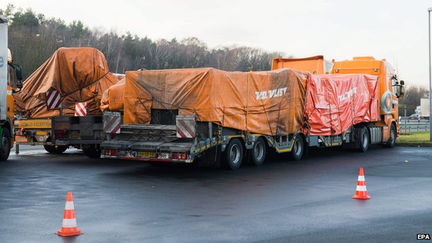 Trucks carrying the wreckage of the passenger airplane MH17 that crashed in Ukraine are parked at a rest stop along the A2 motorway near Hanover, Germany, 08 December 2014.