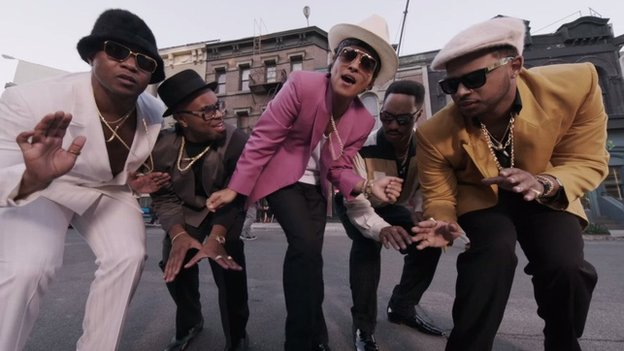 Bruno Mars (centre) in the video for Uptown Funk